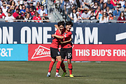 Korea Republic forward Ji Soyun (10) celebrates a goal against USA with defender Son Hwayeon (22) during an international friendly soccer game in Chicago, Sunday, Oct. 6, 2019, in Chicago. The team splayed to a 1-1 tie. (Max Siker/Image of Sport)