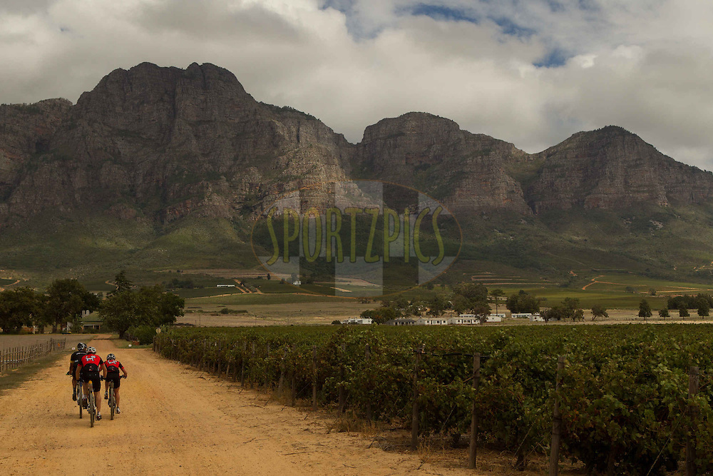 Riders approach the Simonsberg during stage 6 of the 2013 Absa Cape Epic Mountain Bike stage race from Wellington to Stellenbosch, South Africa on the 23 March 2013..Photo by Greg Beadle/Cape Epic/SPORTZPICS