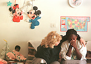 1/5/01 -- (PHOTO BY MIKE FENDER) w/ story, slug: AFRICA, file: 62040 // Cheryl Carter-Shotts, left, comforts Lily, 15, at the Americans for African Adoption foster home in Addis Ababa during a visit in January. Lily was upset that her adoption to a family in Oklahoma was delayed by paperwork and it looked like she would not be able to leave with 15 other children to come to America. Shotts reassured her that she would be coming to America and worked to get the paperwork cleared so she could make the trip.