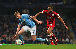 Kevin De Bruyne of Manchester City takes on Bobby Reid of Bristol City - Mandatory by-line: Matt McNulty/JMP - 09/01/2018 - FOOTBALL - Etihad Stadium - Manchester, England - Manchester City v Bristol City - Carabao Cup Semi-Final First Leg