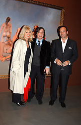 Left to right, MUNIKA SPRUTH, artist GEORGE CONDO and SIMON LEE at an exhibition of paintings by artist George Condo entitled 'Religious Paintings' held at the Spruth Magers Lee Gallery, 12 Berkeley Street, London W1 on 12th October 2004.<br />