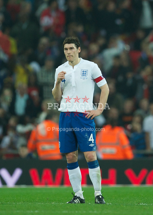 LONDON, ENGLAND - Tuesday, March 29, 2011: England's captain Gareth Barry looks dejected as Ghana score an injury time equalising goal during the international friendly match at Wembley Stadium. (Photo by David Rawcliffe/Propaganda)