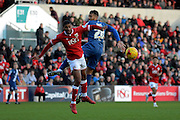 Birmingham City midfielder David Davis and Bristol City defender Mark Little challenge for the ball during the Sky Bet Championship match between Bristol City and Birmingham City at Ashton Gate, Bristol, England on 30 January 2016. Photo by Alan Franklin.