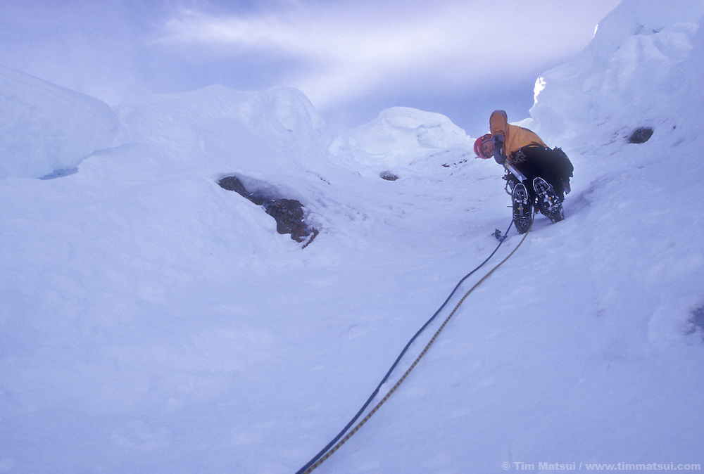Dale Remsberg leads the final pitch of Spindrift Coulior on Big Four Mountain under several large cornices.