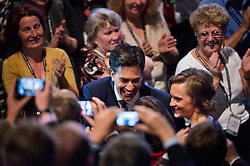© London News Pictures. 24/09/2013 . Brighton, UK.  Labour party leader ED MILIBAND and wife JUSTINE THORNTON being congratulated by delegates as they leave the stage after delivering his Key-note speech on the third day of the Labour Party Conference in Brighton. Photo credit : Ben Cawthra/LNP