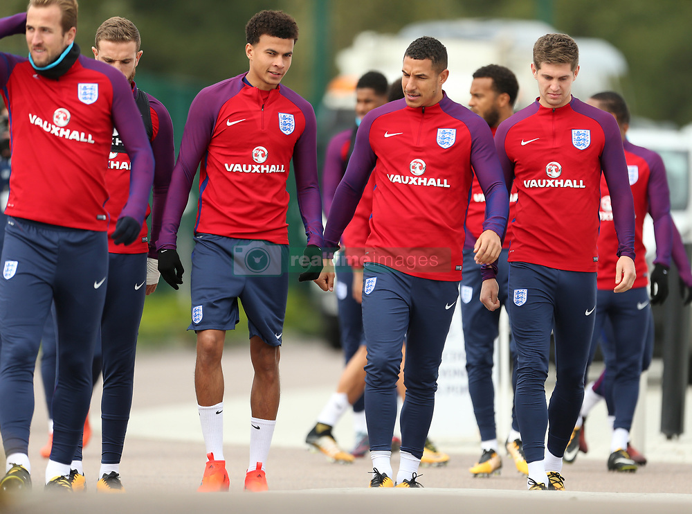 England's Dele Alli (second left) during the training session at Enfield Training Centre, London.