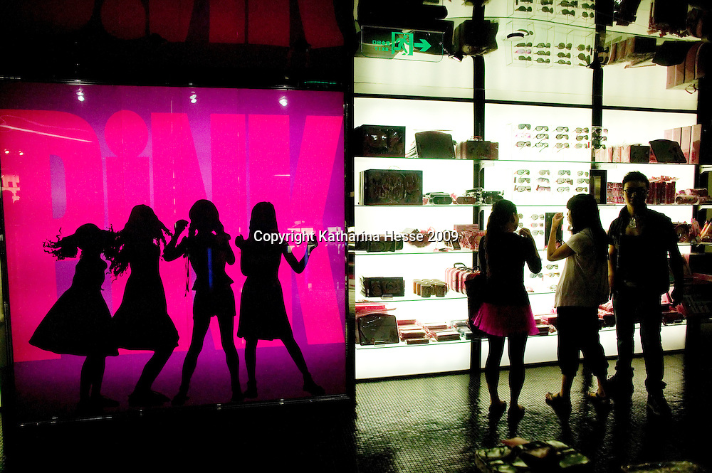 SHANGHAI, JUNE-14 : young Shanghainese choose barbie make-up inside the newly opened Barbie store in Shanghai.