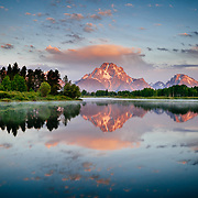 A classic reflection over Oxbow Bend in Grand Teton National Park in Summer.