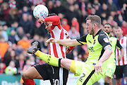 Lincoln City forward Matt Green (10) and Exeter City defender Pierce Sweeney (2) battles for possession  during the EFL Sky Bet League 2 match between Lincoln City and Exeter City at Sincil Bank, Lincoln, United Kingdom on 30 March 2018. Picture by Mick Atkins.