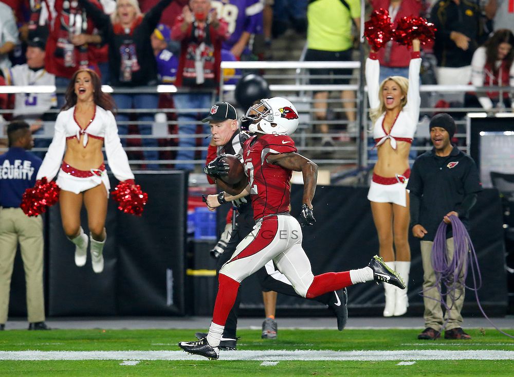 Arizona Cardinals wide receiver John Brown (12) runs for a touchdown after the catch against the Minnesota Vikings during the first half of an NFL football game, Thursday, Dec. 10, 2015, in Glendale, Ariz. (AP Photo/Rick Scuteri)