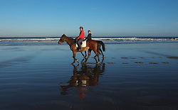© Licensed to London News Pictures. <br /> 04/01/2015. <br /> <br /> Saltburn, United Kingdom<br /> <br /> Riders exercise their horses on a freezing cold start to the day on Saltburn beach in Cleveland.<br /> <br /> Photo credit : Ian Forsyth/LNP