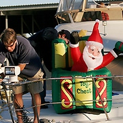 Tucker Stevens (left) and Ken White prepare and decorate  before the North Carolina Holiday Flotilla at Wrightsville Beach...Photo by Logan Mock-Bunting