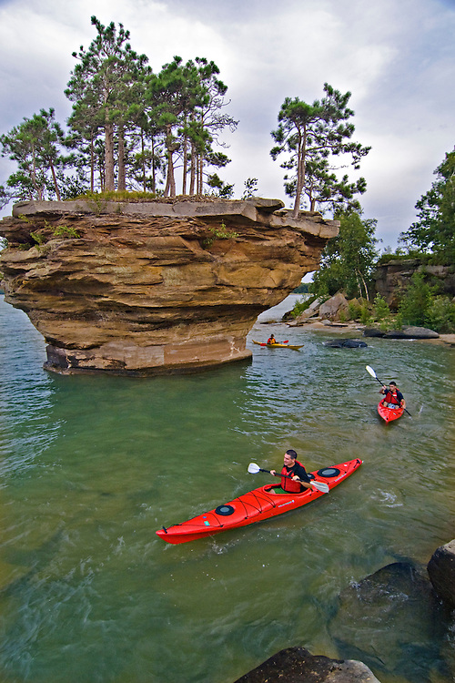 Sea kayaking on Lake Huron at Turnip Rock in the Point Aux Barques area near Port Austin Michigan.