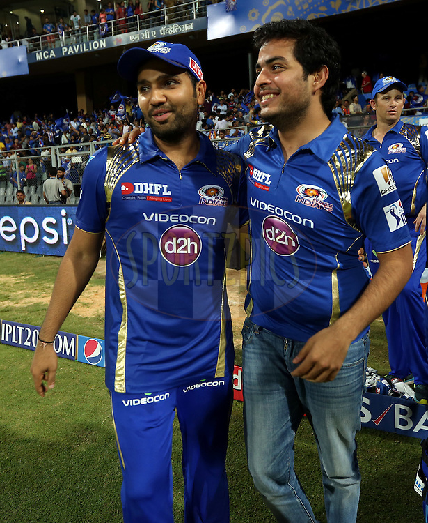 Mumbai Indians captain Rohit Sharma and Akash Ambani son of nita ambani after winning the match 39 of the Pepsi IPL 2015 (Indian Premier League) between The Mumbai Indians and The Delhi Daredevils held at the Wankhede Stadium in Mumbai India on the 5th May 2015.<br /> <br /> Photo by:  Sandeep Shetty / SPORTZPICS / IPL