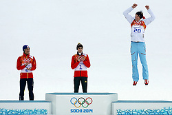 Medalists in the men's normal hill individual ski jumping event at the XXII Olympic Winter Games in Sochi during the flower ceremony, from left: silver medalist Akito Watabe (Japan); gold medalist Eric Frenzel (Germany); bronze medalist Magnus Krog (Norway)