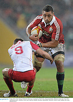 8 June 2013; Toby Faletau, British & Irish Lions, is tackled by Nick Frisby, Queensland Reds. British & Irish Lions Tour 2013, Queensland Reds v British & Irish Lions, Suncorp Stadium, Brisbane, Queensland, Australia. Picture credit: Stephen McCarthy / SPORTSFILE