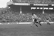 Players chase the ball hoping to gain possession during the All Ireland Senior Gaelic Football Final, Kerry v Dublin in Croke Park on the 28th September 1975. Kerry 2-12 Dublin 0-11.