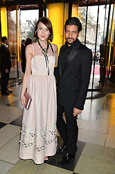 ELLA CATLIFF and NIK THAKKAR at a VIP preview of the V&A's new exhibition 'The Glamour of Italian Fashion' - a comprehensive look at Italian Fashion from 1945-2014 held at The Victoria & Albert Museum, London on 2nd April 2014.