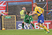 York City goalkeeper Scott Flinders  left stranded by Accrington Stanley defender Matty Pearson goal during the Sky Bet League 2 match between York City and Accrington Stanley at Bootham Crescent, York, England on 28 November 2015. Photo by Simon Davies.