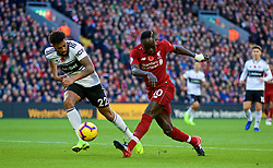 LIVERPOOL, ENGLAND - Sunday, November 11, 2018: Liverpool's Sadio Mane and Fulham's Cyrus Christie (L) during the FA Premier League match between Liverpool FC and Fulham FC at Anfield. (Pic by David Rawcliffe/Propaganda)
