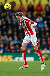 Peter Crouch of Stoke City heads the ball - Photo mandatory by-line: Rogan Thomson/JMP - 07966 386802 - 01/01/2015 - SPORT - FOOTBALL - Stoke-on-Trent, England - Britannia Stadium - Stoke City v Manchester United - New Year's Day Football - Barclays Premier League.