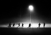 De La Salle Cronulla Rugby league team train in the evening fog at Woolooware oval ,Sydney , NSW, Australia.<br /> Commissioned by Sydney Morning Herald