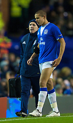 LIVERPOOL, ENGLAND - Thursday, December 17, 2009: Everton's Jack Rodwell kimps off injured with physio Mick Rathbone after only 10 minutes of the UEFA Europa League Group I match against FC BATE Borisov at Goodison Park. (Pic by David Rawcliffe/Propaganda)
