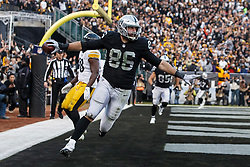 OAKLAND, CA - DECEMBER 09: Tight end Lee Smith #86 of the Oakland Raiders celebrates after catching a pass for a touchdown against the Pittsburgh Steelers during the fourth quarter at the Oakland Coliseum on December 9, 2018 in Oakland, California. The Oakland Raiders defeated the Pittsburgh Steelers 24-21. (Photo by Jason O. Watson/Getty Images) *** Local Caption *** Lee Smith