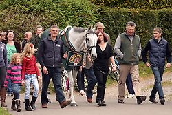 © Licensed to London News Pictures. 15/04/2012. London, UK. Trainer Paul Nicholls parades Neptune Collanges, the 2012 Grand National Winner, around his home village of Ditcheat in Somerset today 15 April 2012. Photo credit : Jason Bryant/LNP