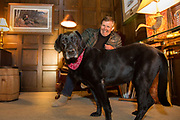 Ron Schara relaxes at home with his famous Labrador Retriever, Raven.