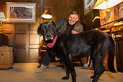Ron Schara relaxes at home with his famous Labrador Retriever, Raven.
