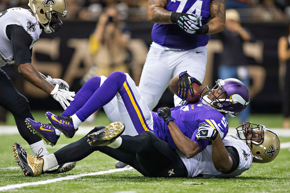 NEW ORLEANS, LA - SEPTEMBER 21:  Teddy Bridgewater #5 of the Minnesota Vikings is sacked by Cameron Jordan #94 of the New Orleans Saints at Mercedes-Benz Superdome on September 21, 2014 in New Orleans, Louisiana.  The Saints defeated the Vikings 20-9.  (Photo by Wesley Hitt/Getty Images) *** Local Caption *** Teddy Bridgewater; Cameron Jordan