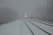 Ames,Iowa,USA Snowy and cold,crisp a train come from the distance, train light