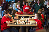 Shaun Jenna from Elm Street School and Drea Crampo from Holy Trinity during a match at the Laconia City Wide Chess Tournament at the Huot Center Saturday morning.  (Karen Bobotas/for the Laconia Daily Sun)