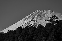 View of Mount Fuji covered with snow from the deck of a tourist pirate ship on Lake Ashi. Image taken with a Nikon 1 V3 camera and 70-300 mm VR telephoto zoom lens.
