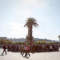 People gather near the Izmir Clock Tower on  Konak Square in Izmir, Turkey