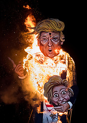 © Licensed to London News Pictures. 05/11/2016. Edenbridge, UK. An effigy of US Presidential candidate Donald Trump burns at the annual Edenbridge traditional fireworks night celebrations. The 36 ft tall figure is holding the head of his Democrat rival Hillary Clinton. Photo credit: Peter Macdiarmid/LNP