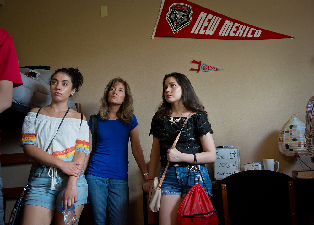 mkb070517e/metro/Marla Brose -- Listening to a tour guide, from left, Holly Lindley of Hobbs, left, her mom Bernadette Lindley and Giovanni Guzman of Las Cruces, stand inside a dorm room in Hokona Hall during a campus tour, July 5, 2017, in Albuquerque, N.M. (Marla Brose/Albuquerque Journal)