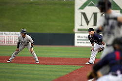 12 August 2011:  Steve Alexander protects first base as Luis Parache takes a lead during a game between the Rockford River Hawks and the Normal Cornbelters at the Corn Crib in Normal Illinois.