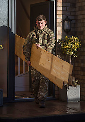 © Licensed to London News Pictures. 29/12/2015. York, UK. A  Royal Electrical and Mechanical Engineer soldier removes flood damaged flooring from a house in the centre of York on December 29, 2015. Further rainfall is expected over coming days as Storm Frank approaches the east coast of the country. Photo credit: Ben Cawthra/LNP