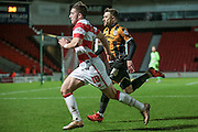 Lynden Gooch (Doncaster Rovers) runs past JJ Hooper (Port Vale) to try and get a cross in during the Sky Bet League 1 match between Doncaster Rovers and Port Vale at the Keepmoat Stadium, Doncaster, England on 26 January 2016. Photo by Mark P Doherty.