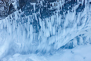 Large icicles form on a steep wall near Snoqualmie Falls, Snoqualmie, Washington after several days of subfreezing temperatures. During periods of extreme cold, mist from the waterfall freezes to the canyon walls.