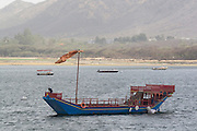 India, Rajasthan, Udaipur A boat ride in lake Pichola, A traditional Rajasthan boat
