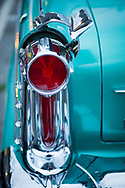 Bellmore, New York, USA. 11th August 2017.  At Bellmore Friday Night Car Show, Frank Martocci, of Bellmore, is owner of Bugmobile, owner of green Oldsmobile, 1958, with left taillight shown in detail where chrome piece is swung open to reveal opening the gas is put in tank.