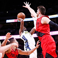 09 April 2018: Denver Nuggets forward Paul Millsap (4) takes a jump shot over Portland Trail Blazers center Jusuf Nurkic (27) during the Denver Nuggets 88-82 victory over the Portland Trail Blazers, at the Pepsi Center, Denver, Colorado, USA.
