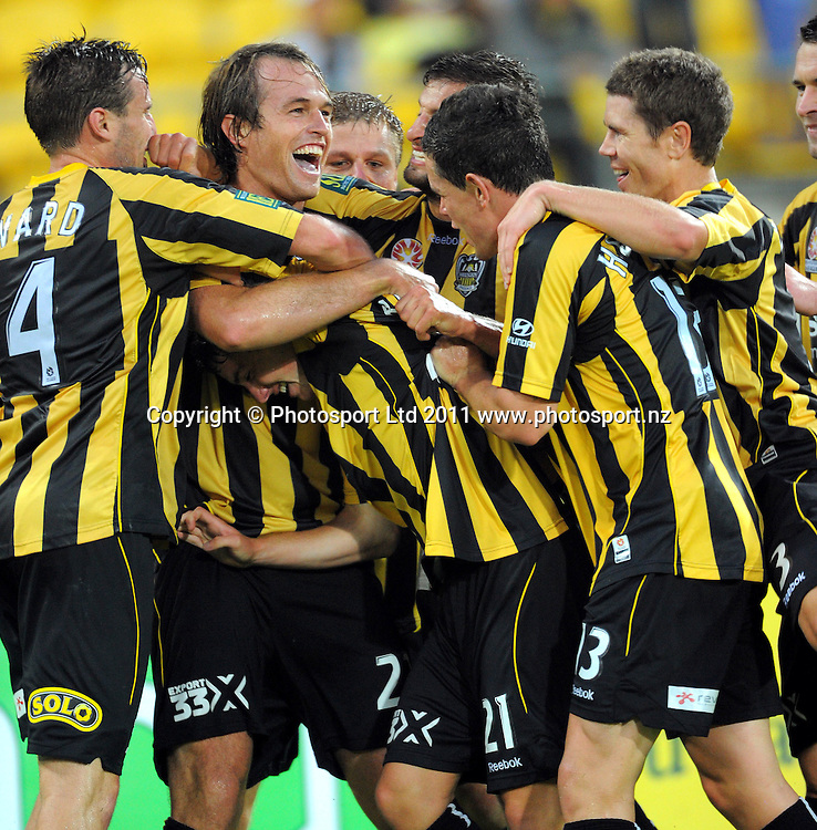 Phoenix players celebrate Dylan Macallister's goal. A-League football - Wellington Phoenix v Melbourne Victory at Westpac Stadium, Wellington, New Zealand on Wednesday, 5 January 2011. Photo: Dave Lintott/PHOTOSPORT