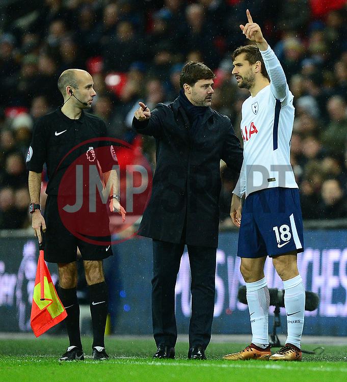 Tottenham Hotspur manager Mauricio Pochettino talks to Fernando Llorente of Tottenham Hotspur prior to coming on the pitch. - Mandatory by-line: Alex James/JMP - 04/01/2018 - FOOTBALL - Wembley Stadium - London, England - Tottenham Hotspur v West Ham United - Premier League