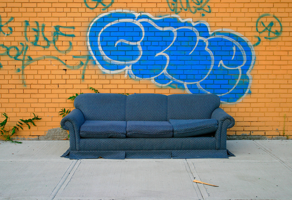 Blue couch yellow wall blue graffitti cloud Red Hook, Brooklyn, New York<br />