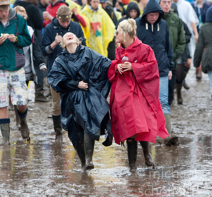 Fans in the mud on Saturday, at T in the Park 2012, held at Balado, in Fife, Scotland..