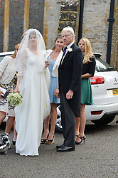 The Bride PRINCESS FLORENCE VON PREUSSEN and her father PRINCE NICHOLAS VON PREUSSEN at the wedding of Princess Florence von Preussen second daughter of Prince Nicholas von Preussen to the Hon.James Tollemache youngest son of the 5th Lord Tollemache held at the Church of St.Michael & All Angels, East Coker, Somerset on 10th May 2014.